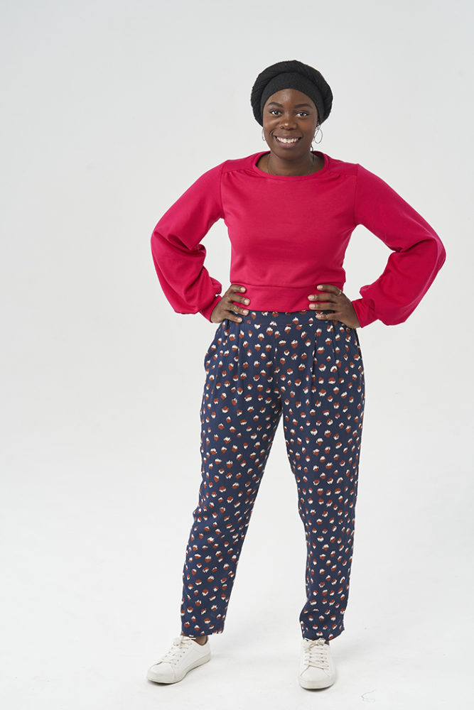 Salma wearing the Carrie Trousers with a hot pink Roxy Jumper