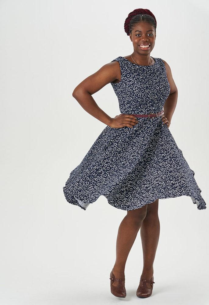 Salma twirls in a navy Betty Dress