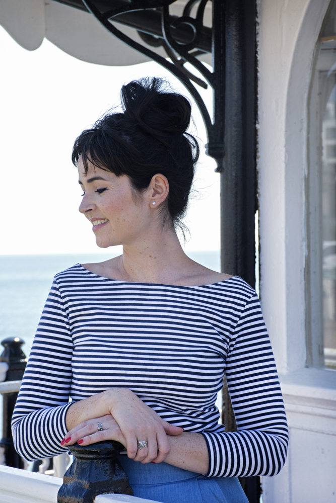 Lisa Comfort in a striped Edie Top by the sea