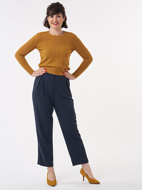 Lisa Comfort in a mustard jumper and Peggy Trousers