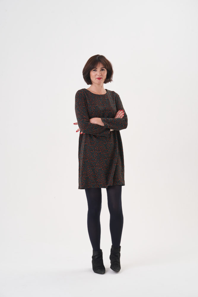 Lisa Comfort weraing the Ultimate Shift Dress, black tights and ankle boots