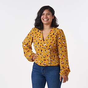 Cat wearing a yellow Esther Blouse
