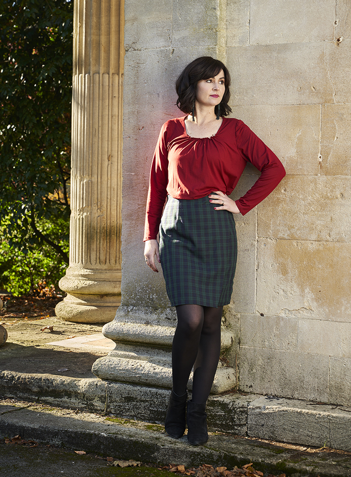 Lisa wearing the Ivy Skirt in a smart checked pattern