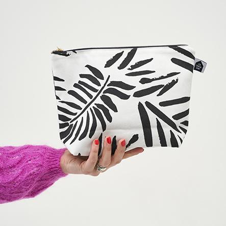 Zipped toiletries bag hand sewn using a monochrome palm print fabric