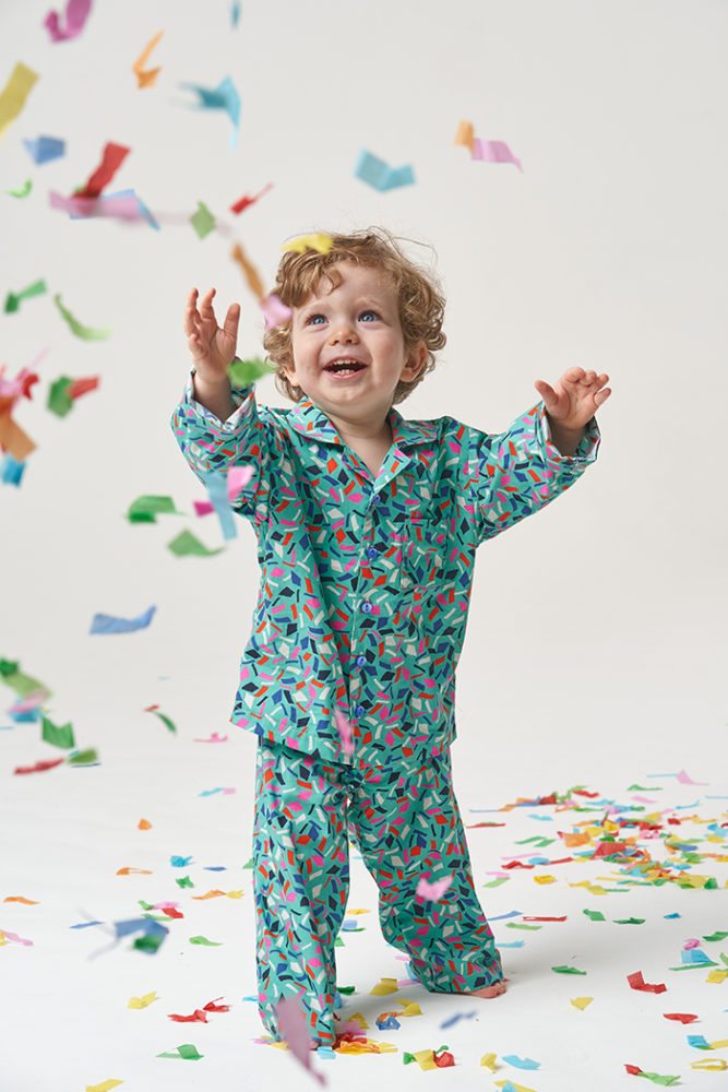 Ezra wearing super cute Pomegranate Pyjamas while trying to catch giant confetti