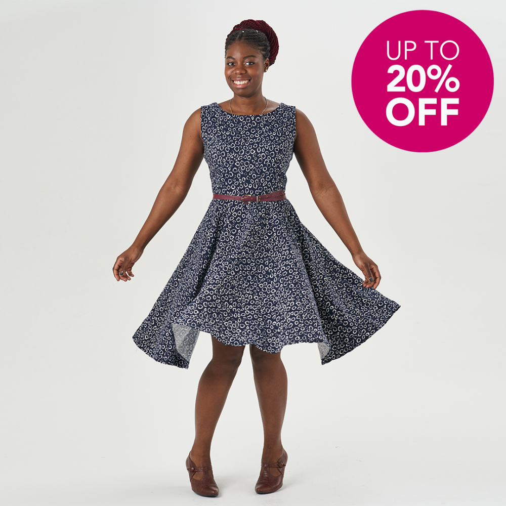 """Salma wearing a blue Betty Dress with a pink roundel that says """"Up To 20% Off"""""""