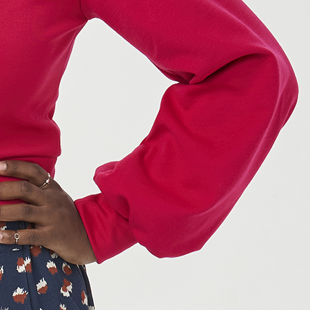 A bell sleeve in pink ponte di roma fabric