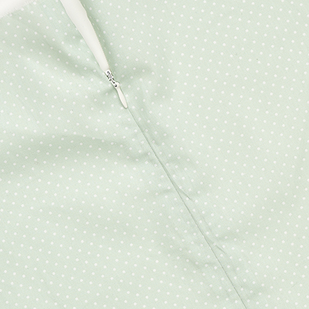 A white concealed zip in mint fabric