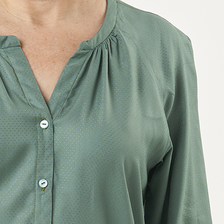 Close up of a green Zadie Blouse
